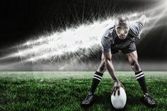 Image composée du portrait du sportif jouant le rugby et le 3d Photographie stock libre de droits