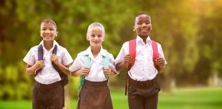 Image composée du portrait intégral des étudiants dans des uniformes images stock