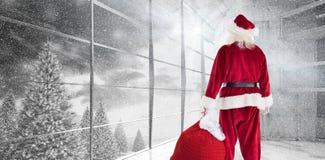 Image composée du sac de transport à Santa de cadeaux Image libre de droits