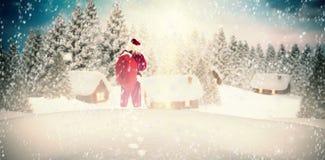 Image composée du sac de transport à Santa de cadeaux Photo stock