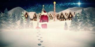 Image composée du sac de transport à Santa de cadeaux Image stock