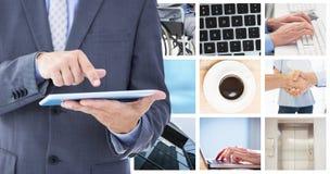 Image compos?e d'homme d'affaires utilisant le PC de comprim? image stock