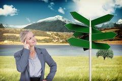Image composée de femme d'affaires pensant avec le doigt sur la tête Photographie stock libre de droits