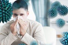 Image composée de jeune homme soufflant son nez Photos stock