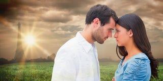 Image composée des couples fâchés regardant fixement l'un l'autre Image stock