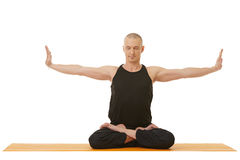 Image of concentrated man doing yoga exercise Stock Photos