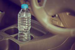 Image concept Bottled water was left in the car for a long time. To drink it? . Royalty Free Stock Photo