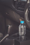Image concept Bottled water was left in the car for a long time. To drink it? . Royalty Free Stock Images