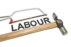 Image concept old and dirt cropped  hammer with mini handsaw placed on top word labour Royalty Free Stock Images