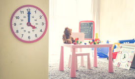 Image Concept Toys to play with time/ Interior of colorful playing room for kids Royalty Free Stock Photo