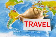 Image of the concept of travel, map with a shell. A piece of paper is written to travel Royalty Free Stock Photo