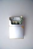 Image conceptuelle affichant le coût de fumage Photo stock