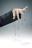 Image conceptuelle de la manipulation d'entreprise Image stock