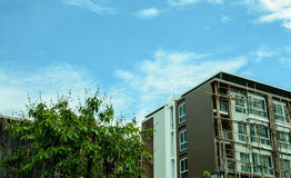 Image of condo on afternoon with blue sky background. Stock Photos