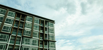 Image of condo on afternoon with Blue sky background. Royalty Free Stock Images