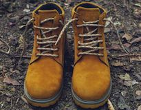 Brown leather boots shoes vintage in forest. This image consists of a pair of brown leather boots shoes vintage in forest Royalty Free Stock Images