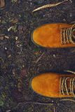Brown leather boots shoes vintage in forest half. This image consists of a pair of brown leather boots shoes vintage in forest Stock Photo