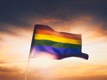 Image contrastée de drapeau gai au coucher du soleil Image stock