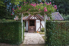 Image of a cottage in the English garden. Stock Images