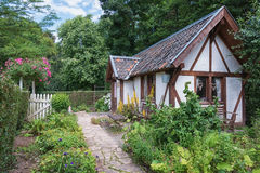 Image of a cottage in the English garden. Stock Photography