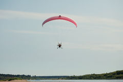 Image of couple flying on Moto paraglider Royalty Free Stock Image