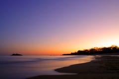 Image courante de coucher du soleil de plage de chant image stock