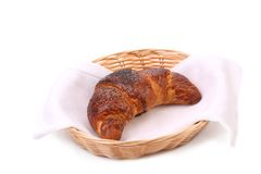 Image of croissant with poppy in a basket. Royalty Free Stock Images