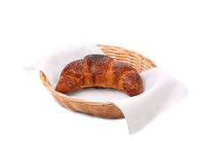 Image of croissant with poppy in a basket. Royalty Free Stock Photo