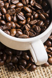 Image a cup of coffee beans. Closeup of a cup of coffee beans with some blur background stock photography