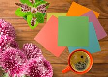 Image of a cup of coffee, flowers, paper stock image