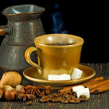Image of a cup of coffee and spices on a black background. Cup of coffee and spices on a black background Stock Photo