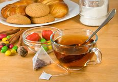 Image of a cup of tea, cakes and buns Stock Photography