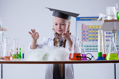 Image of cute chemist conducting experiment in lab Stock Photo