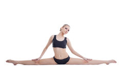 Image of cute flexible gymnast sitting on splits. Isolated over white background Stock Images
