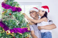 Cute girl and her father decorating Christmas tree Royalty Free Stock Images