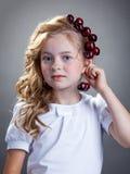 Image of cute girl tries on cherries as earring Stock Image