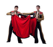 Image of cute guys posing dressed as toreadors. Image of funny men posing dressed as bullfighters royalty free stock photography