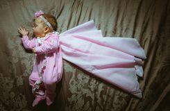 Image of cute little girl in pink suit and cloak Stock Image