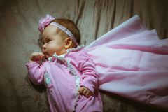 Image of cute little girl in pink suit and cloak Royalty Free Stock Image