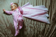 Image of cute little girl in pink suit and cloak Stock Photo