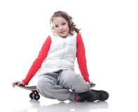 Image of cute little girl posing with skateboard Royalty Free Stock Photos