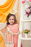 Image of cute little model posing in smart dress Royalty Free Stock Images