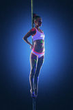 Image of cute sporty girl posing hanging on pole Royalty Free Stock Photos