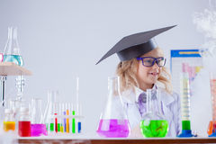 Image of cute surprised girl posing in laboratory Royalty Free Stock Images