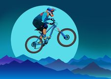 Image of a cyclist on a background of mountains and a big  Stock Photography