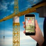 Image 3d composée de la mi section de la femme d'affaires tenant le téléphone portable Image stock