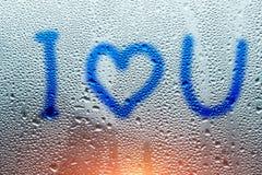 Image d'un coeur et un point d'interrogation sur une fenêtre misted humide Emo Photo libre de droits