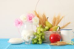 image of dairy products and fruits over wooden background. Symbols of jewish holiday - Shavuot. Stock Photography
