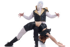 Image of dancer with hidden face and his partner Stock Photography