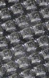 image de microscopie de Refléter-lumière d'une surface métallique avec des altitudes carrées photographie stock
